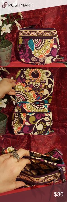 Vera Bradley little flap hipster handbag This Vera Bradley bag is a crossbody in the pattern plum crazy. The front has a zipper compartment and there are two main compartments one with a zipper closure and one with a magnetic closure. Flipping the purse open from The Middle, there is another zipper compartment and a slot for your driver's license. The handbag measures 9 x 7.5 by 1.5 inches. The strap expands from 26 to 52 inches. Vera Bradley Bags Crossbody Bags