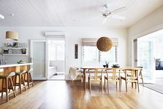 A creative family transformed a rundown Byron Bay backpackers' into a stylish beach house and boutique hotel. Take a tour of their laidback but luxe renovation. Open Plan Kitchen Dining Living, Dining Rooms, Byron Bay Beach, White Side Tables, Beach House Decor, Home Decor, Dream Home Design, Coastal Decor, Coastal Homes