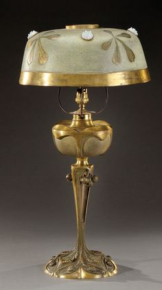 GEORGES LELEU Art Nouveau table lamp with chestnut motif, signed, and dated 1905, 60 cm H.