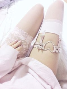 Jewels: socks pink white lace pretty girly spikes thigh highs thigh high socks heart garter belt