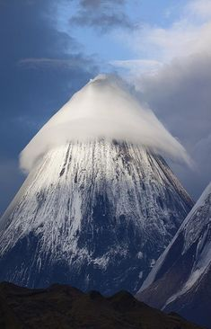 ✶Lenticular Cloud over Klyuchevskaya Sopka Mountain, RUSSIA by Denis Budkov: Klyuchevskaya Sopka is a stratovolcano, the highest active volcano of Eurasia. Its steep, symmetrical cone towers about 100 kilometres from the Bering Sea. and is part of the natural Volcanoes of Kamchatka✶