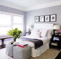 Slip-covered white headboard and ottomans.