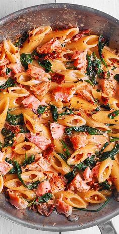 Salmon Pasta with Sun-Dried Tomato Cream Sauce and Spinach - quick and easy dinner made in 30 minutes! Pan-seared salmon is combined with the delicious penne in a flavorful, restaurant-quality cream sauce. Salmon is a Salmon Pasta Recipes, Creamy Salmon Pasta, Healthy Salmon Recipes, Salmon Dishes, Spicy Salmon, Seafood Recipes, Spinach Recipes, Dinner Recipes, Cooking Recipes