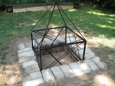 Our very own fire pit!  We built it out of bricks and pavers that we found on our property, then James built the steel guard framework