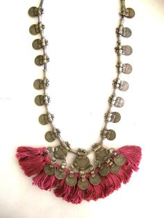 Love this ethnic boho feeling necklace- with its washed red tassels, coins and heavy aged metal! Great inspiration for a boho-chic statement necklace.