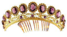 Oval amethyst tiara-comb, gilt metal with an open-work band of circular amethysts and gilt foliates