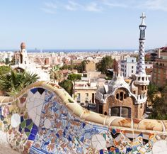 Vibrant mosaic tiles on the peak of a terraced hill make Park Güell in Barcelona, Spain one of the world's most beautiful city parks.