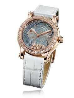 The new Chopard Happy Fish watch showcases the skill of the Maison's artisans, who have engraved the fish from shimmering mother-of-pearl and enhanced its contours with gold leaf. The graded shades of snow-set blue sapphires to simulate the sea are housed in the 36mm rose gold case with a diamond-set bezel.