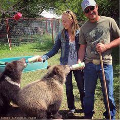 Amber and Shawn feeding bear cubs 6-2016