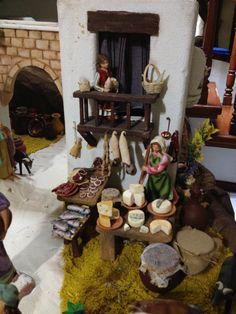 Nacimiento/ Belén de Gabriela Aranda 2013. Guadalajara, México Puesto de carnes y quesos. Arriba: niña hilandera.