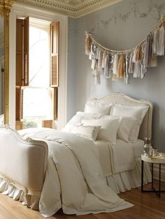 inspiration image: the bed, color scheme, wall colors, Moroccan wedding blanket bed topper, rich golden brown shutters