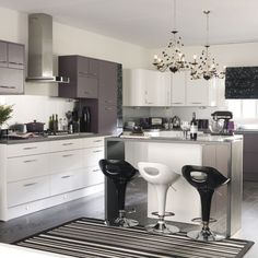 Via housetohome.co.uk - We love the monochrome and purple theme in this kitchen.