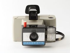 Polaroid Swinger II Land Camera Untested  In good cosmetic condition. Shutter fires. Sold as a collectors item.