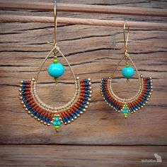 Handcrafted macrame earrings made with linhasita 0,5 mm thread, acai beads, glass seed beads, 925 sterling silver 24K gold plated beads, gold plated earwires, brass drop.  The thin 0.5 mm linhasita thread gives a very fine look to the earrings.  Used colors of thread: teal, autumn
