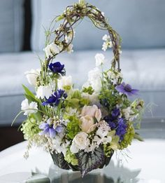 Spring-basket-in-container-covered-with-foliage-Francoise-Weeks