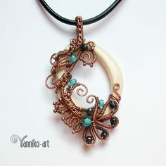 One of a kind wire wrapped hand-carved natural bone pendant embellished with glass beads.