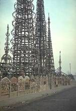 In 1921, Italian immigrant Simon Rodia began constructing his work of folk art in his yard — three large towers and 14 spires, minarets and smaller constructions embedded with objects such as tiles, bottle glass and seashells — in his spare time. He stopped working on it in 1954, signed his property over to a neighbor and moved to Martinez, Calif.