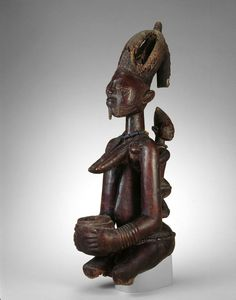 Abogunde of Ede (active late 19th century)  Yoruba  Ede, Oyo region, Nigeria    Female Figure with Offering Bowl, Late 19th century    Wood, beads, and traces of pigment