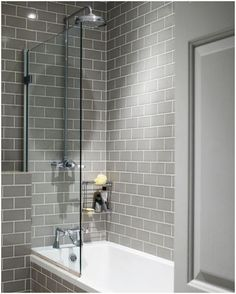 Grey subway tiles look great in this modern bathroom. - Grey subway tiles look great in this modern bathroom. Upstairs Bathrooms, Grey Bathrooms, Bathroom Renos, Beautiful Bathrooms, Bathroom Ideas, Budget Bathroom, Simple Bathroom, White Bathroom, 1950s Bathroom