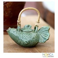 @Overstock - Ceramic 'Green Koi' Teapot (Indonesia) - A koi comes to life as a ceramic teapot by Putu Oka Mahendra to represent good fortune. Crafted by hand, the teapot shows rich details carved carefully into the clay, and a rattan handle continues the Indonesian theme.    http://www.overstock.com/Worldstock-Fair-Trade/Ceramic-Green-Koi-Teapot-Indonesia/7744301/product.html?CID=214117  $69.99