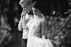 groom gently embracing his bride