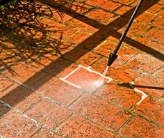 THIS TOOL IS A PRESSURE WASHER. Look how the Pressure Washer magically transforms dirty grout into clean, white grout! Pressure washers are the best tool to clean outside areas such as driveways and patios.