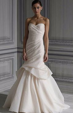 This is the most beautiful chiffon Monique Lhuillier spring 2012 collection. Ivory jacquard strapless draped bodice gown with hand bustled trumpet skirt. Comes with a crystal Monique Lhuillier sash.