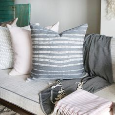 """A stone grey, sand and white organic striped weave in a durable fabric. Size: 20"""" x 20"""". Made in Canada - 100% Olefin."""