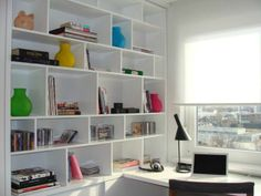 tiny home office + a lot of book storage