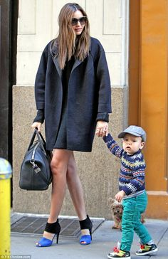 Leggy: The 29-year-old showed off her legs in a knitted black dress paired with a near-matching coat