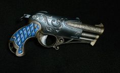 An absolutely gorgeous Steampunk pistol, I love the ornamental scroll work and the blue leather look hand grips. This is my idea of an Art Nouveau Steampunk weapon. This is an elegant and decoratively styled pistol but dont be fooled by its charming looks, it packs quite a punch and can fire three darts without reloading.  Its a brand new Nerf Rebelle Charmed Dauntless Blaster. I made a couple of modifications, I removed the pull ring part of the cocking mechanism which I though was too…