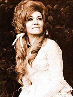 """Dottie West.....Dottie is considered one of the genre's most influential and groundbreaking female artists. Dottie West's career started in the early 1960s, with her Top 10 hit, """"Here Comes My Baby Back Again,"""" which won her the first Grammy Award for Best Female Country Vocal Performance in 1965. In the 1960s,"""