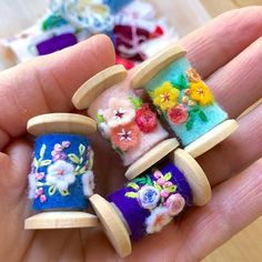 I worked on these cute little spool pendants this afternoon. They are made using new wooden spools but Im planning to make some using vintage spools which will be fun because theyll all be a little different. Wooden Spool Crafts, Wooden Spools, Contemporary Embroidery, Modern Embroidery, Craft Projects, Sewing Projects, Felt Embroidery, Embroidery Stitches, Thread Spools