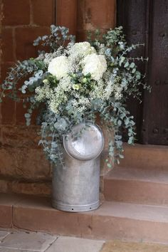Country churches deserve country decorations. Loved the churns the bride and groom found for us to fill. www.passionforflowers.net