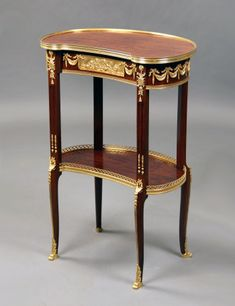 A FIne Late 19th Century Transitional Style Gilt Bronze Mounted Kidney Shaped Table