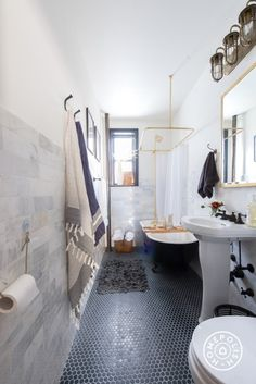"A Lesson in Beautiful Bathrooms - ""Sticking with two or three colors throughout the space and adding depth with textures will open up a small bathroom. For example, here we added visual textures with the marble subway tiles and we juxtaposed the black floor tiles with light grouting."" - @Homepolish Brooklyn"