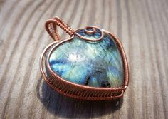 Laser etched flashy labradorite heart shaped pendant & and
