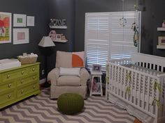 Love the dark gray walls with pops of bright green! #nursery #nurserydecor #chevron