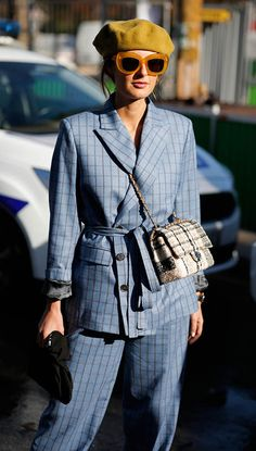 Chic Ways to Sport A Matching Pantsuit: Cuffed sleeves, big sunglasses and a bright-coloured beret will turn a serious power suit into a playful one.