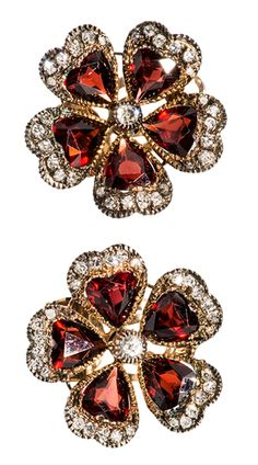 Russian garnets and mine cut diamond set Feminine Floral design earrings set with Russian garnets and mine cut diamonds in 18 k gold and silver. Sold as a set with multi strand pearl necklace that includes floral centerpiece of garnets and diamonds. Clip earrings with post that can be removed. Photo courtesy of Wayne Smith Jewels via 1stdibs