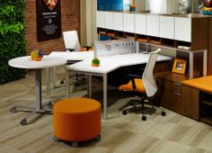 Swish casegoods with Totem Pods and Proxy seating add a splash of color to this work space!