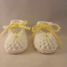 White and Yellow Baby booties $8.99 Our Knitted baby booties keep your baby's little feet warm and comfy. They're knitted from soft wool that doesn't irritate your baby's skin. Material: 100 % Acrylic. Sizes from Newborn to 12 months.