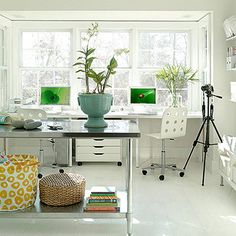 The perfect studio -- they say people are more creative when you have views overlooking nature, I think I could be pretty creative in this space with the bright open windows. I love the open, airiness of this room with the white palette and industrial workspace details.