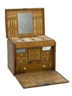 """A straw work casket made by a Napoleonic prisoner of war held in England.Prisoners were encouraged to produce straw marquetry rather than items such as hats, to avoid competing with established local industries. Prisoners Of War, Maritime Museum, Small Drawers, Pink Paper, Bone Carving, Marquetry, Weird Art, Casket, Decorative Items"