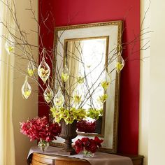 This showstopping arrangement puts the season's flowers on display. Orchids are used in the urn here, but two dozen red roses would also be eyecatching
