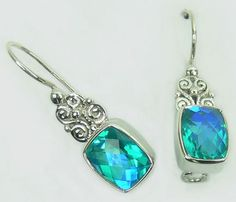 Sterling Silver Earrings with Doublet Rainbow Perido Stone (AJER02) Specifications:  Silver wt. in gm : 4.35 Stone wt. in gm : 0.90 Gross Wt. in gm: 5.25
