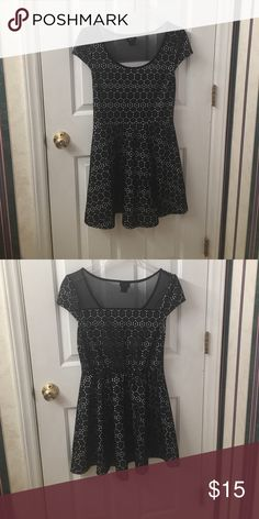 Super cute dress, comes down to mid-thigh. Short sleeves and partial sheer back. Comes to about mid thigh. It is mostly cotton and super comfy. Goes great with scarves and winter jackets. Rue 21 Dresses Mini