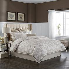 Achieve timeless elegance with the stunning Wamsutta Secret Garden Duvet Cover Set, featuring a beautiful large cream floral print on a natural ground with a taupe trim and natural flange. Includes the coordinating pillow shams to complete your space.