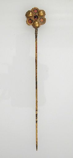 Hairpin Date: 7th century Geography: Made in Northern France Culture: Frankish Medium: Gold or gilt, glass paste, stone, filigree