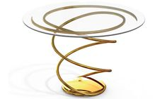 A double-spiral side table finished in 24K gold. Brad Pitt dabbles in furniture design - of course it's gold!